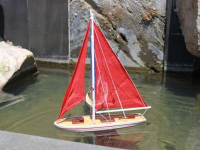 It Floats 21 - Red Floating Sailboat - Red Sails