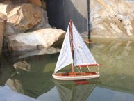 It Floats 12 - Red Floating Sailboat