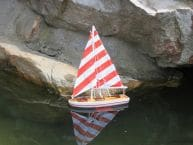 Wooden It Floats 12 - Rustic Red Striped Floating Sailboat Model picture